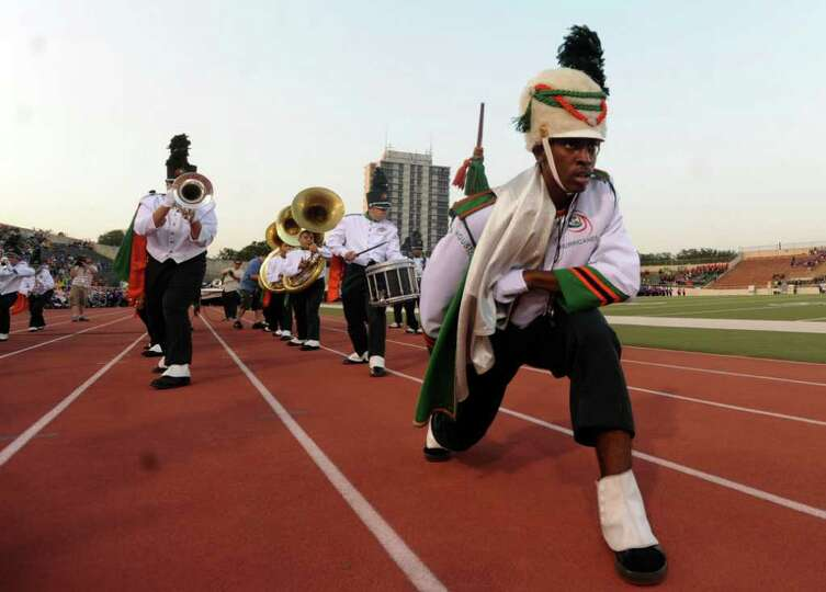 Sam Houston High School drum major Edward Harris and band members dance during the 73rd Battle of Fl