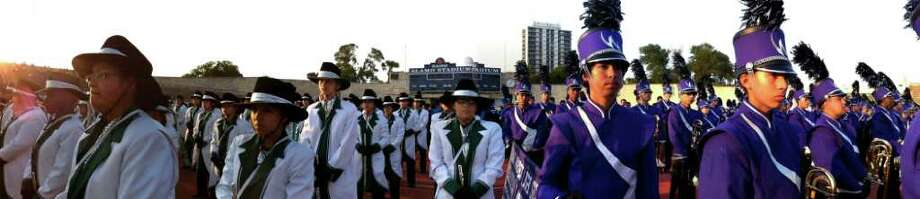 Members of the Southwest and Warren High School bands prepare to perform before the 73rd Battle of Flowers Band Festival at Alamo Stadium on Thursday, April 14, 2011. This picture is a digital panoramic that competes several exposures. Photo: BILLY CALZADA, Billy Calzada/Express-News / gcalzada@express-news.net