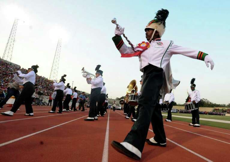 Edward Harris of the Sam Houston High band leads his group during the 73rd Battle of Flowers Band Fe