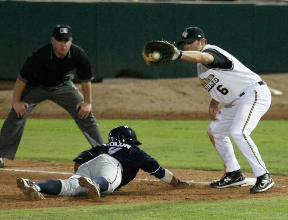Northwest Arkansas Naturals runner Christian Colon slides safely back to first base ahead of the pickoff throw to Missions first baseman Cody Decker. Decker helped the Missions win 7-4 after a six-run rally in the eighth. Photo: J. Michael Short, J. Michael Short/Special To The Express-News / THE SAN ANTONIO EXPRESS-NEWS