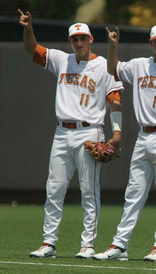 UT infielder Alex Silver (left) prepares for the first start of his career Saturday. He had a hit and a run against Baylor. Photo: JOHN DAVENPORT, John Davenport/Express-News / SAN ANTONIO EXPRESS-NEWS