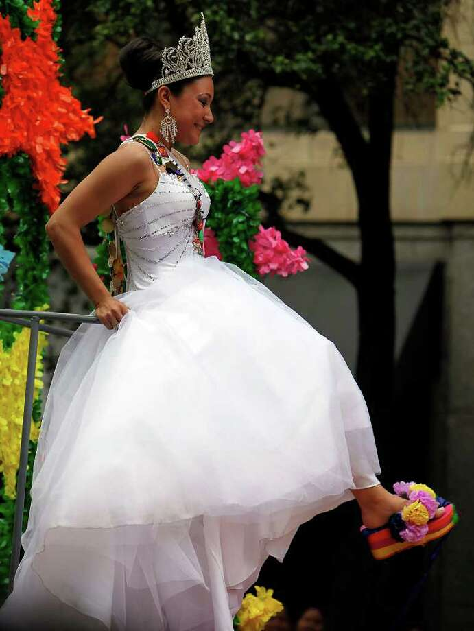 Miss Fiesta San Antonio 2009 Jessica Nicole Ramirez shows off her colorful footwear at the 2009 Battle of Flowers parade on Apr. 24, 2009. Ramirez is a senior at Our Lady of the Lake University majoring in Theater Arts. All of the parade queens have had a tradition of wearing colorful shoes to show off to parade watchers.  Kin Man Hui/kmhui@express-news.net Photo: Kin Man Hui, San Antonio Express-News / San Antonio Express-News