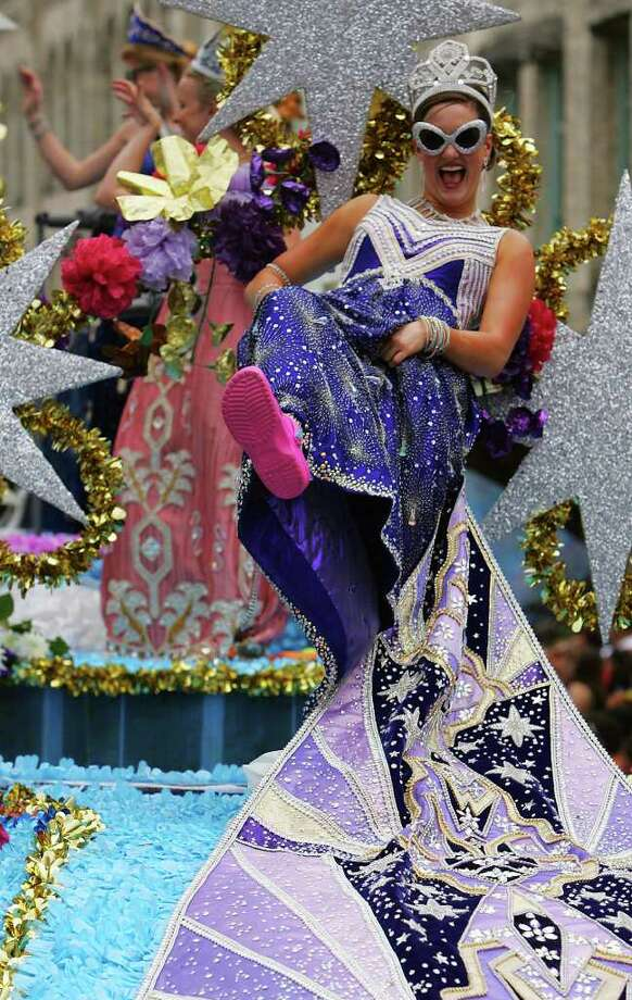 METRO - 2:32 PM: Molly Mitchell Ward, the Duchess of Space Odysseys, shows her shoes during the Fiesta Battle of Flowers Parade Friday, April 28, 2006. BAHRAM MARK SOBHANI/STAFF Photo: BAHRAM MARK SOBHANI, SAN ANTONIO EXPRESS NEWS / SAN ANTONIO EXPRESS NEWS
