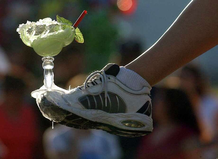 METRO  ---   Marla Santos, Miss Alamo Silver Wings Airborne Association 2003, shows off her shoes Saturday night April 26, 2003 as she makes her way down Broadway Avenue during the Fiesta Flambeau parade.      (WILLIAM LUTHER/STAFF) Photo: WILLIAM LUTHER, SAN ANTONIO EXPRESS-NEWS / SAN ANTONIO EXPRESS-NEWS
