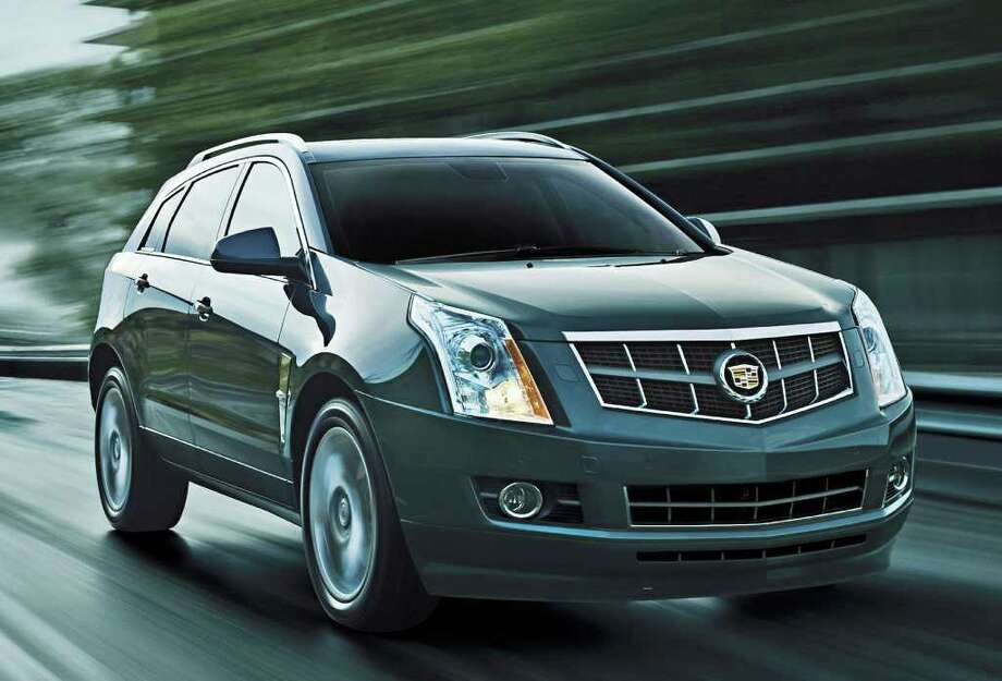 The Cadillac SRX, shown here as a 2011 model, is a premium midsize crossover utility vehicle that competes against such models as the Lexus RX 350. Photo: General Motors Co., COURTESY OF GENERAL MOTORS CO.