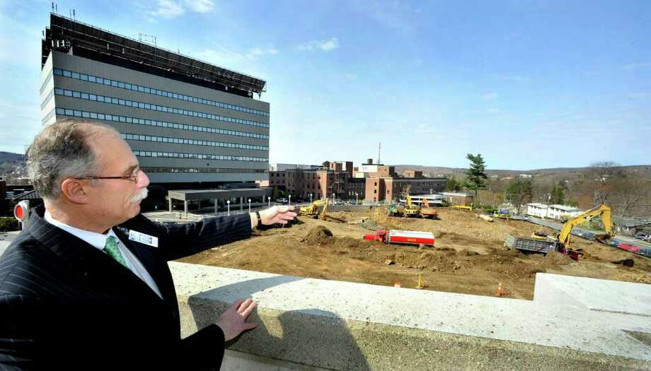 Morris Gross, vice president of Western Connecticut Healthcare, points out construction of the new Tower expansion project from the Hospital Avenue parking garage at Danbury Hospital, Friday, April 15, 2011. Photo: Michael Duffy / The News-Times