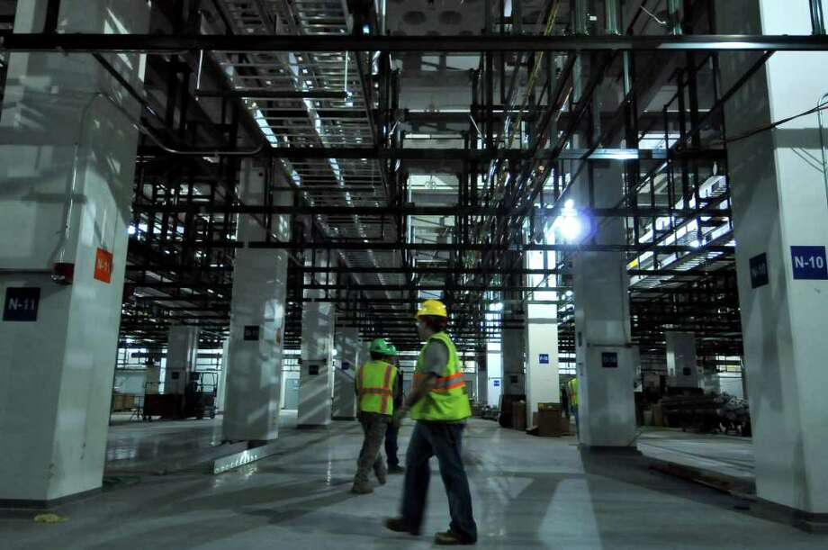 View of the sub fab area below a partially completed clean room in the new GlobalFoundries chip fabrication plant under construction on Thursday April 7, 2011 in Malta, NY. (Philip Kamrass/ Times Union ) Photo: Philip Kamrass
