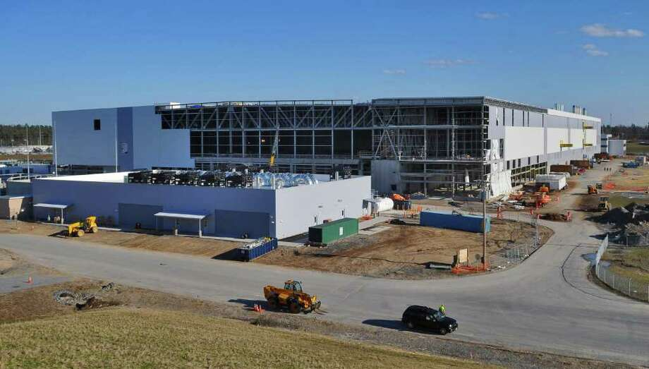 View of the rear of the new GlobalFoundries chip fabrication plant under construction on Thursday April 7, 2011 in Malta, NY.  (Philip Kamrass/ Times Union ) Photo: Philip Kamrass