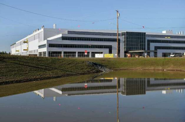 View of the front of the new GlobalFoundries chip fabrication plant under construction on Thursday April 7, 2011 in Malta, NY.  (Philip Kamrass/ Times Union ) Photo: Philip Kamrass
