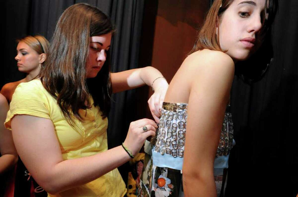 Senior Emily Devaney pins junior Madeline Rudden before the start of the sixth annual Earth Day fashion show at Lauralton Hall in Milford, Conn. Friday, April 15, 2011.