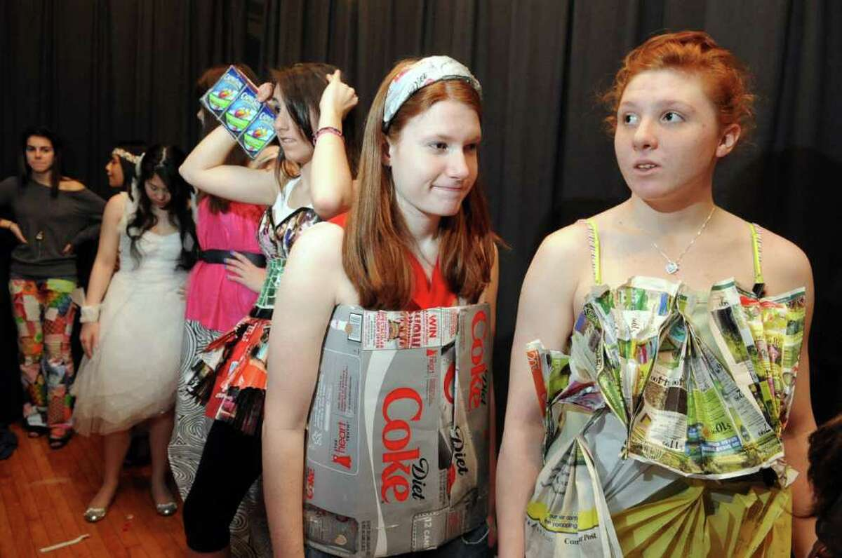 Models line up for the sixth annual Earth Day fashion show at Lauralton Hall in Milford, Conn. Friday, April 15, 2011.