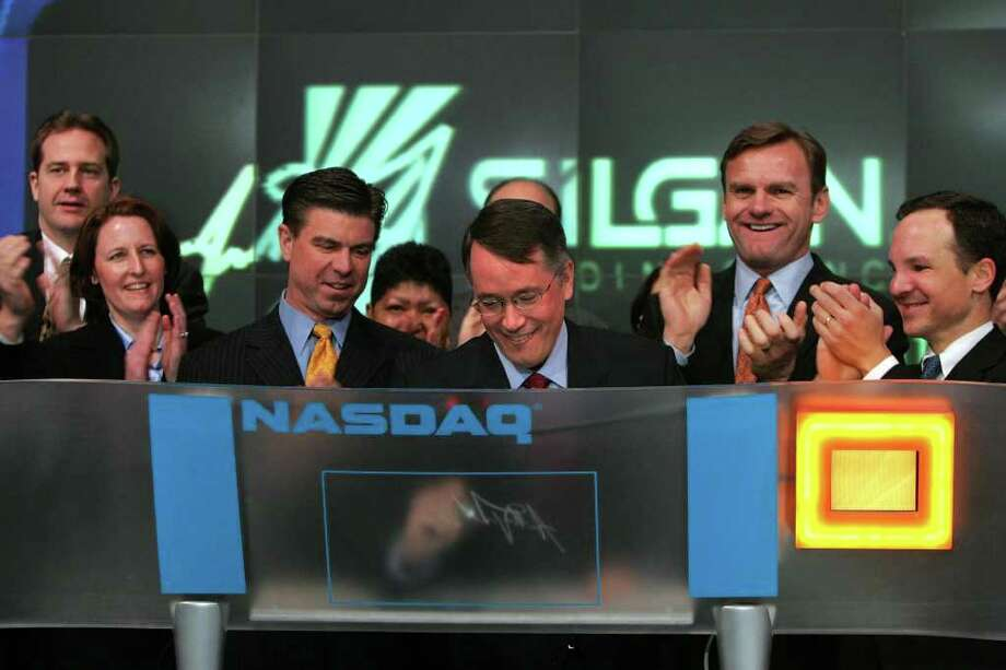 Anthony J. Allott, Chief Executive Officer of Silgan Holdings, signs his name after ringing The NASDAQ Stock Market Opening Bell on Feb. 13,2007. Photo: Contributed Photo / Stamford Advocate Contributed
