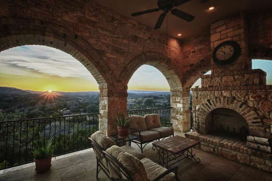 This four-bedroom, six-bathroom Boerne home offers a sunset view over the Hill Country. The 6,556-square-foot house sits on a 6-acre lot and has a list price of $2.8 million. Photo: COURTESY PHOTO / Kuper Sothebyÿs International Realty