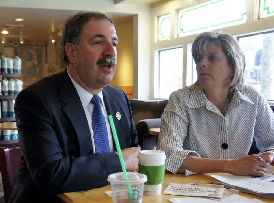 State Reps. Jonathan Steinberg, D-136, and Kim Fawcett, D-133, meet with constituents at the Starbucks coffee house at 925 Post Road East in Westport on Friday, April 15, 2011. Photo: Paul Schott / Westport News