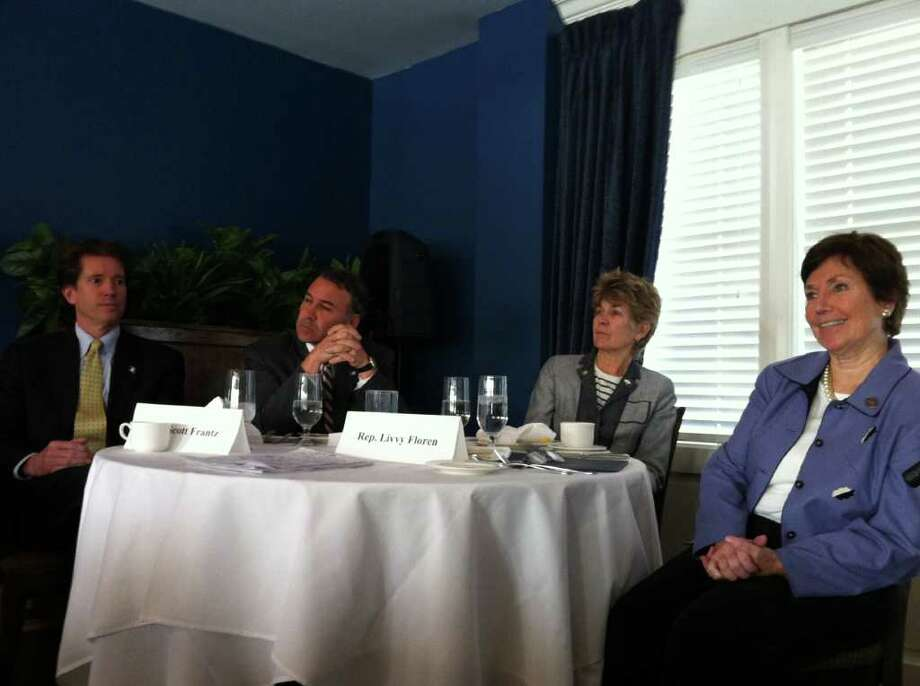 Greenwich's state delegation listens to a question during the Greenwich Chamber of Commerce annual Legislative Breakfast & Business Roundtable Friday at the Greenwich Water Club in Cos Cob. Pictured, from left, are: state Sen. L Scott Frantz, R-36th District, and state Reps. Alfred Camillo, R-151st District, Lile Gibbons, R-150th District, and Livvy Floren, R-149th District. Photo: Frank MacEachern / Greenwich Time