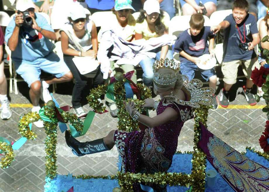 "Nicole Earleen Swift, Princess of the Bold American Spirit, shows her ""Spurs"" boots as people react during the Battle of Flowers Parade on Friday, April 15, 2011. BILLY CALZADA / gcalzada@express-news.net Photo: BILLY CALZADA, SAN ANTONIO EXPRESS-NEWS / gcalzada@express-news.net"