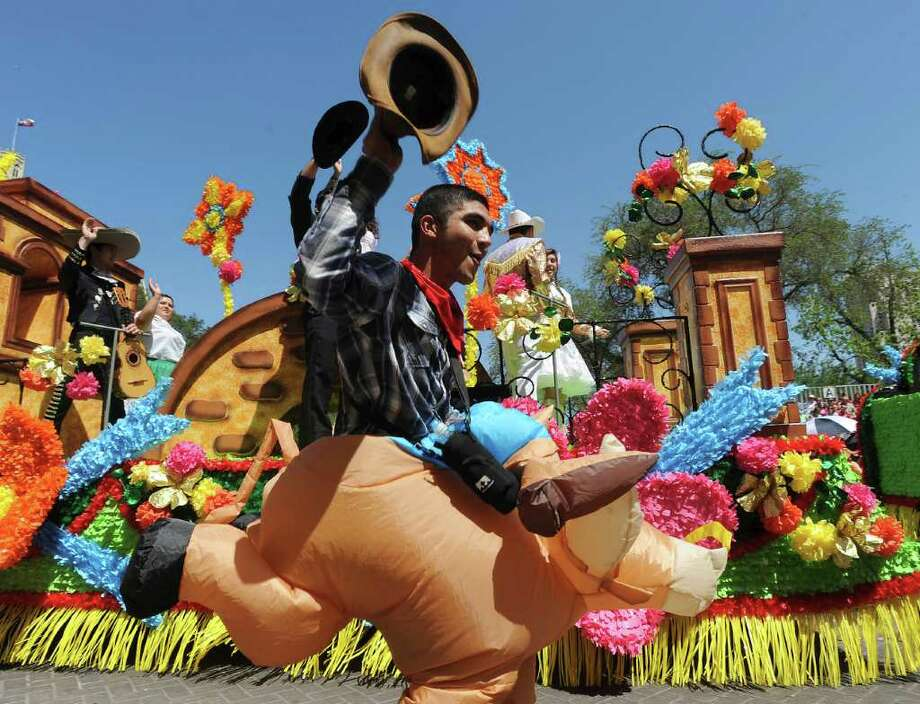 Daniel Campa of Harlandale High School rides a balloon horse during the Battle of Flowers Parade on Friday, April 15, 2011. BILLY CALZADA / gcalzada@express-news.net Photo: BILLY CALZADA, SAN ANTONIO EXPRESS-NEWS / gcalzada@express-news.net