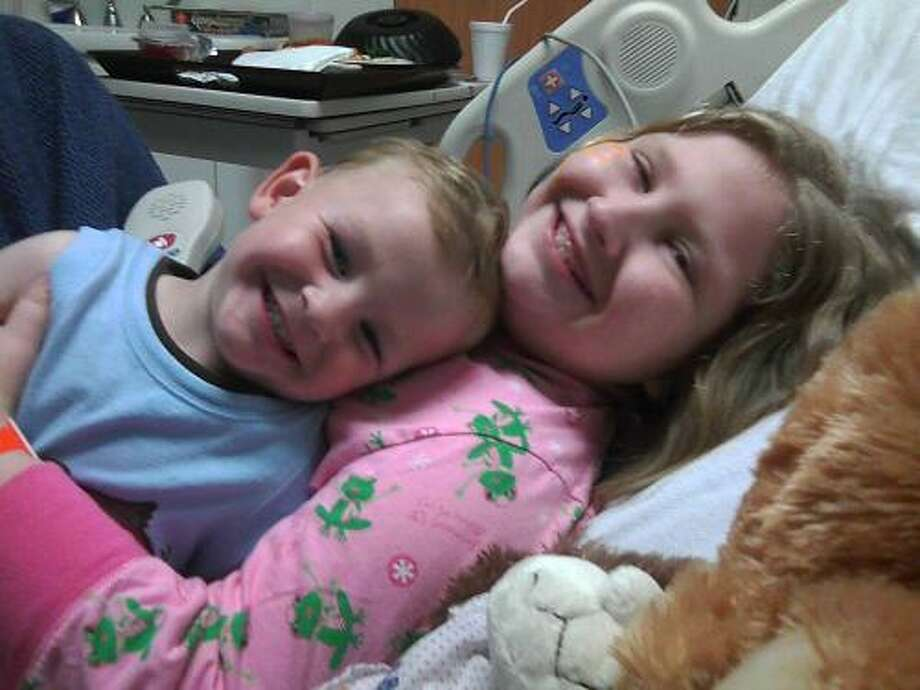 Destiny Goss hugs her younger brother, Alex, at the hospital in April 2010. Destiny, now 11, has kidney failure and received a transplant from her father in 2004. That kidney is now being rejected. Photo provided by the Goss family.