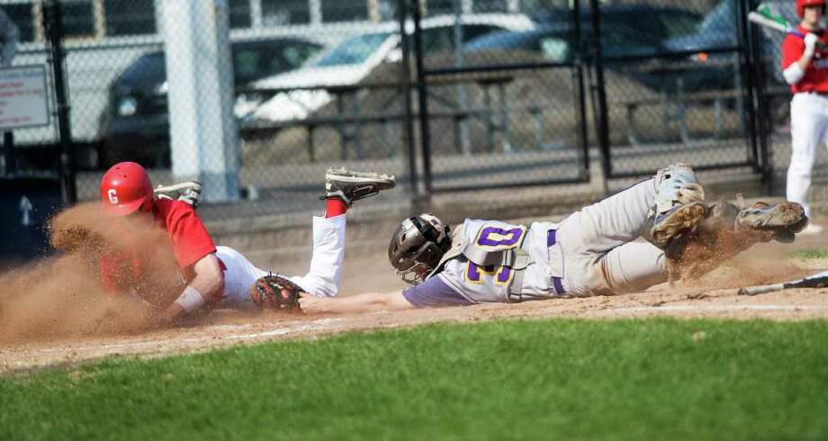 Greenwich High School's Taylor Olmstead slides safely past Westhill High School's catcher Zach Phillipson in baseball action at Cubeta Stadium in Stamford, Conn. on Friday April 15, 2011. Photo: Kathleen O'Rourke, Stamford Advocate / Stamford Advocate