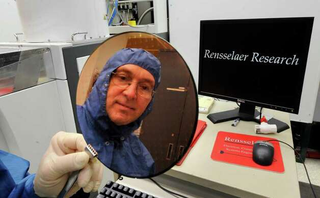 An 8 inch wafer etched with many chips was shown by Kent Way, Equipment Process Engineer during a tour of the RPI  Cleanroom in the Center for Industrial Innovation in Troy, N.Y. April 15, 2011. (Cindy Schultz / Times Union) Photo: Skip Dickstein