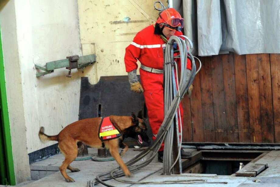 "A firefighter and his dog participate to a quake drill on April 14, 2011 in Villard-Bonnot, south eastern France. The drill called ""Richter 38"" is part of the government earthquake prevention program and is supervised by the Isere region prefect. Photo: AFP/Getty Images"
