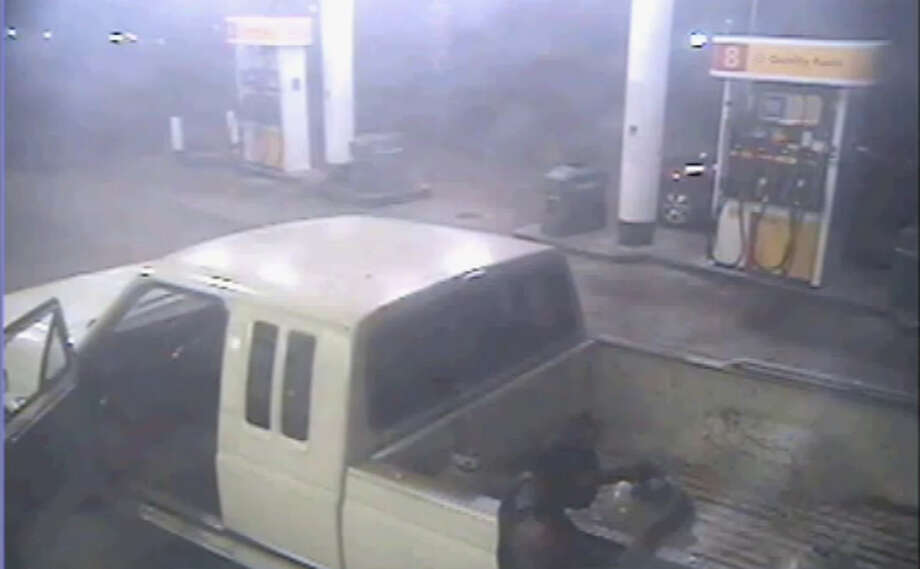 Police say that two men in a white pickup truck stole seven Blue Rhino propane tanks from a local gas station on April 4.
