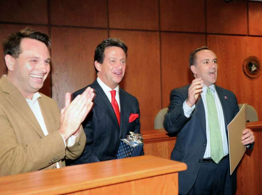 Greenwich First Selectman Peter Tesei, right, declares April 15, 2011 as Regis Philbin Day in Greenwich Friday afternoon at Greenwich Town Hall.  At left is Greenwich Selectman Drew Marzullo and at center is ABC Television Weatherman Bill Evans, who stood in on Philbin's behalf to accept the town's proclamation. Photo: Bob Luckey / Greenwich Time