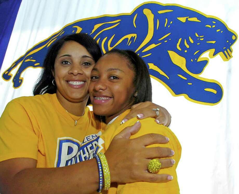 Ozen guard Asia Booker, right, is this year's Super Gold Player of the Year for girls basketball. Booker, a junior, led Ozen to the state tournament this year just as her mother, Ramona Locke, left, did for the Hardin-Jefferson team in the 1980s.  Locke is an assistant coach for Ozen, and her daughter is hungry to get back to the state tournament next year as a senior. Dave Ryan/The Enterprise / Beaumont