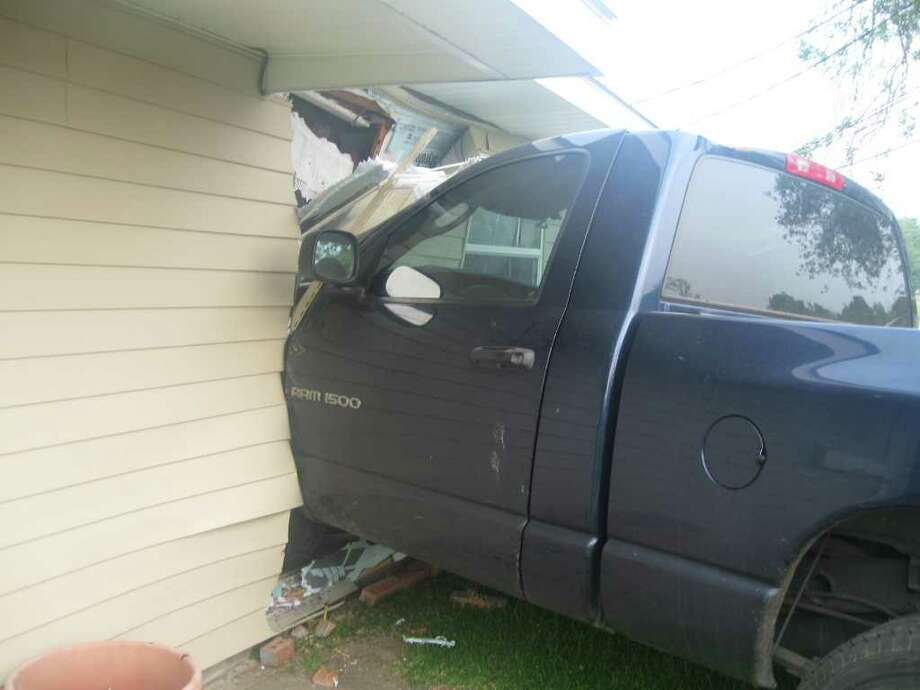 A truck hit a house on Charles in Groves on Friday morning. Photo courtesy of  the Groves Police Department