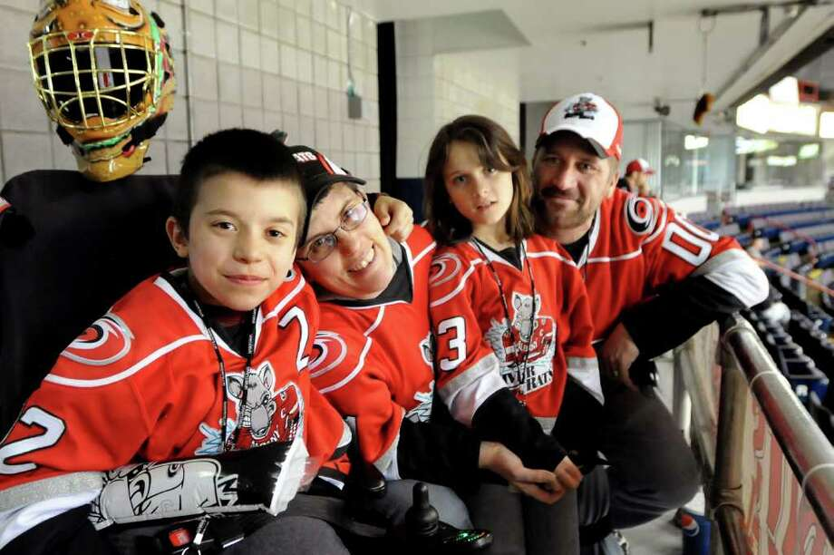 River Rats fan Zach Bennett, 10, left, joins his mother Danielle, sister Jenna, 8, and father Randy at the playoff game against  the Hershey Bears on Thursday, April 29, 2010, at Times Union Center in Albany, N.Y.  Photo: CINDY SCHULTZ