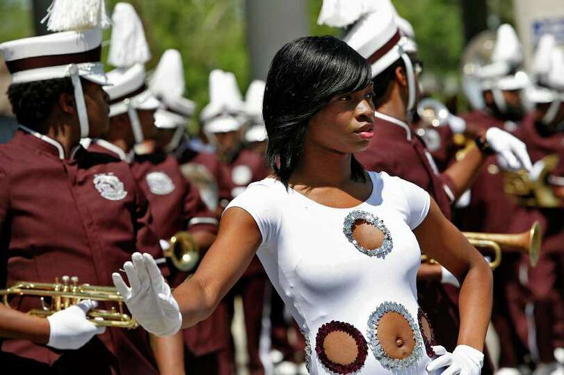 Texas Southern University Ocean of Soul Marching Band member begins to dance during the Battle of Fl