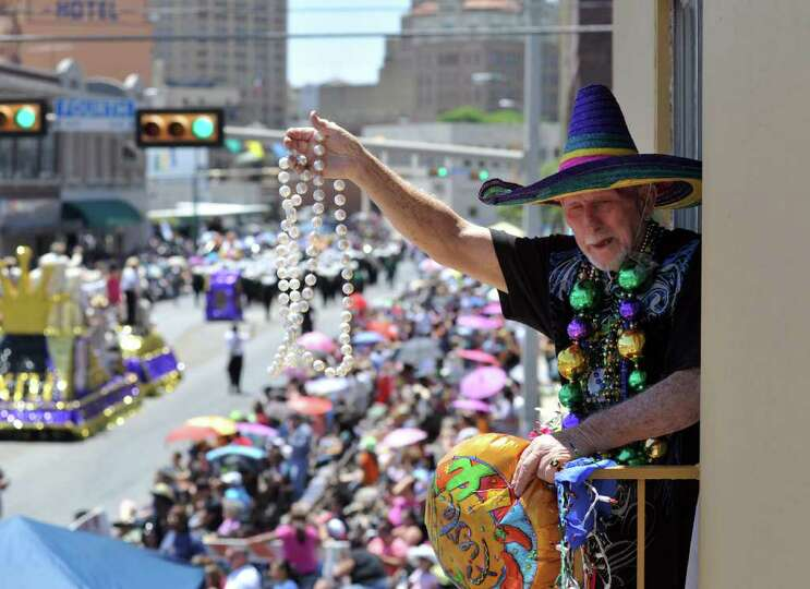 Weldon Albertson waves and celebrates the Battle of Flowers Parade. This was Albertson's 43rd par