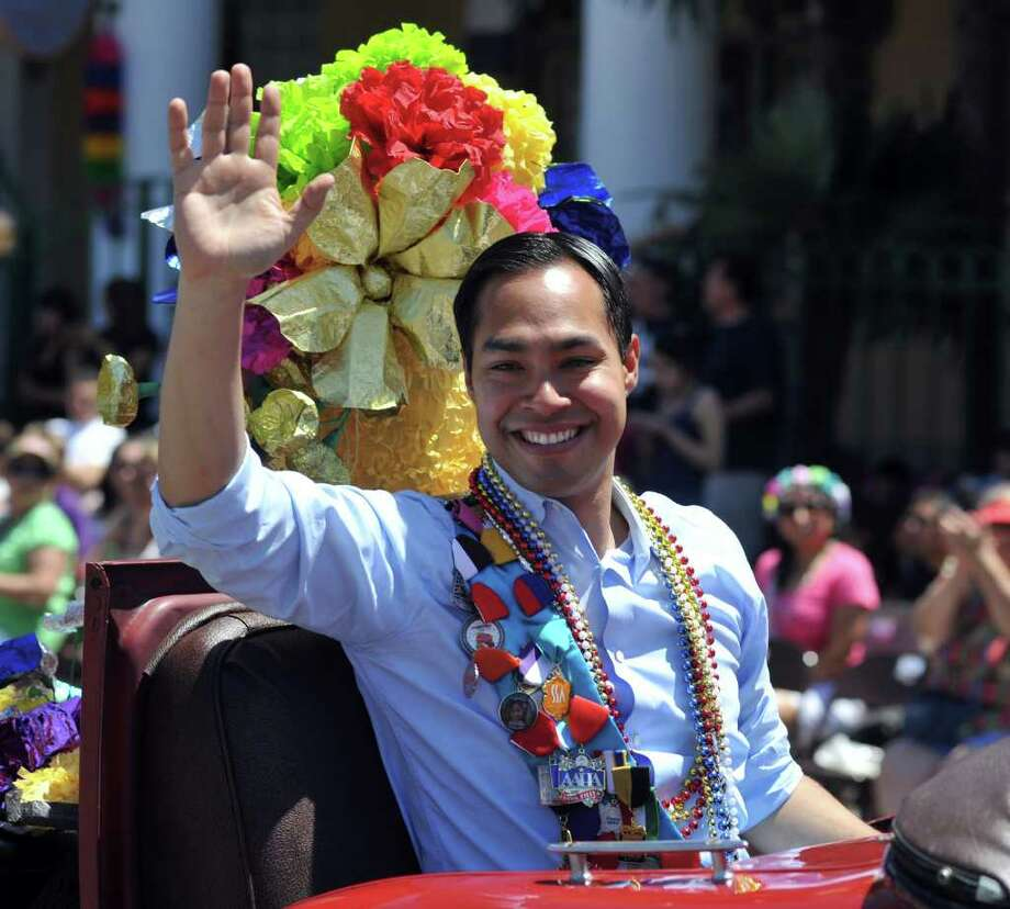 SLUG: BOF2011RJ-No Photo Request number-April 15, 2011-San Antonio, Texas---Mayor Julan Castro waves to the crowd while traveling down Broadway St. during the Battle of the Flowers Parade 4/15.  Photo by Robin Jerstad/Special to the Express-News Photo: Photo By Robin Jerstad/Special To The Express-News / Robin Jerstad