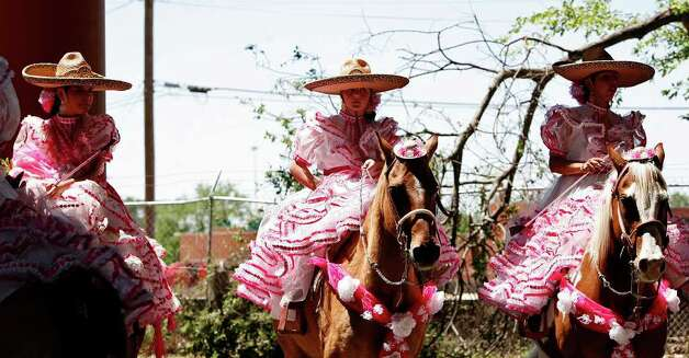 "Members of Escaramuza  ""Rosas de Castilla"" wait to enter the parade route during the Battle of Flowers Parade in San Antonio on Friday, April 15, 2011. Bria Webb/Special to the Express-News Photo: BRIA WEBB, SAN ANTONIO EXPRESS-NEWS"