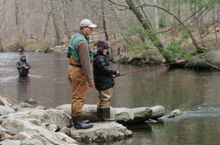 Steven Getlik and his son Tyler Getlik, 9 of Stamford, fish along the Mianus River on opening day of trout season in Stamford, Conn. on Saturday April 16, 2011. Photo: Kathleen O'Rourke / Stamford Advocate