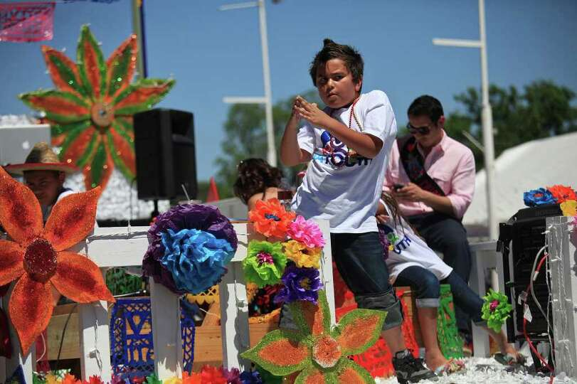 metro - Kris Lopez, 9, dances on the San Antonio Youth float during the Battle of Flowers Parade in