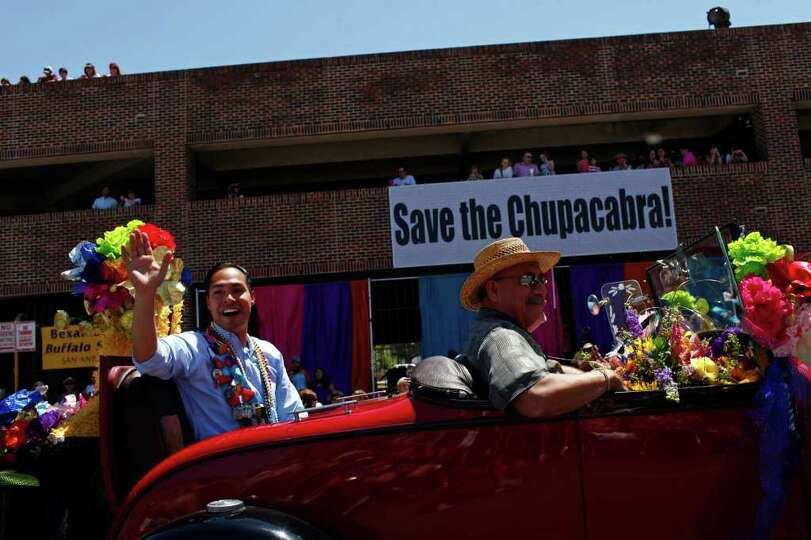 metro - Mayor Julian Castro waves to spectators during the Battle of Flowers Parade in San Antonio o