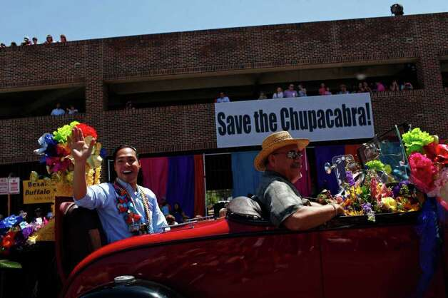 metro - Mayor Julian Castro waves to spectators during the Battle of Flowers Parade in San Antonio on Friday, April 15, 2011. LISA KRANTZ/lkrantz@express-news.net Photo: LISA KRANTZ, SAN ANTONIO EXPRESS-NEWS / SAN ANTONIO EXPRESS-NEWS