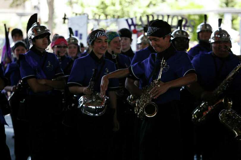 Members of Warren High School marching band, break out in dance as their percussion plays during the