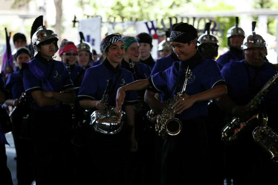 Members of Warren High School marching band, break out in dance as their percussion plays during the Battle of Flowers Parade in San Antonio on Friday, April 15, 2011. Bria Webb/Special to the Express-News Photo: BRIA WEBB, SAN ANTONIO EXPRESS-NEWS