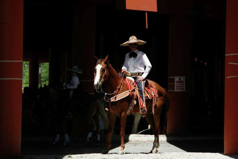 Mario Sandoval, a member of Charros Del Bajro, waits to enter the parade route during the Battle of
