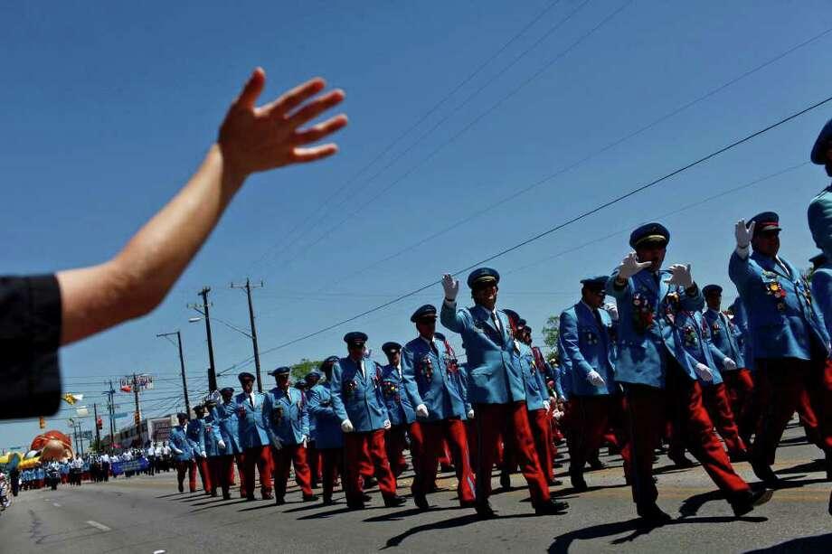 metro - The Texas Cavaliers march in the Battle of Flowers Parade in San Antonio on Friday, April 15, 2011. LISA KRANTZ/lkrantz@express-news.net Photo: LISA KRANTZ, SAN ANTONIO EXPRESS-NEWS / SAN ANTONIO EXPRESS-NEWS