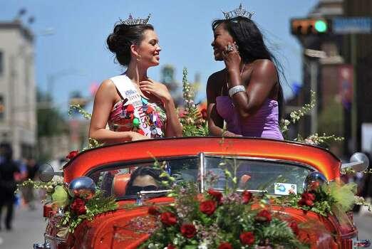 metro - Miss San Antonio Domonique Ramirez, left, and Miss Bexar County Ashley Dixon ride together during the Battle of Flowers Parade in San Antonio on Friday, April 15, 2011. LISA KRANTZ/lkrantz@express-news.net Photo: LISA KRANTZ, SAN ANTONIO EXPRESS-NEWS / SAN ANTONIO EXPRESS-NEWS
