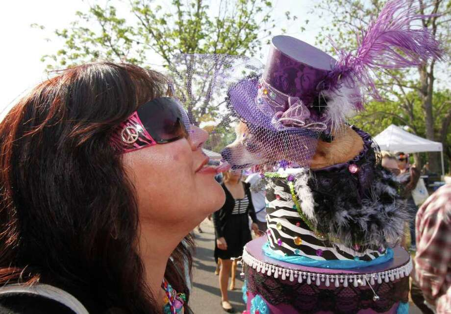"Elaine Pierce kisses her dog ""Myra,"" who won ""Top Dog"" at the Fiesta Pooch Parade in Alamo Heights, Texas on Saturday, April 16, 2011. Photo: ALICIA WAGNER CALZADA, SPECIAL TO THE EXPRESS-NEWS / Alicia Wagner Calzada"