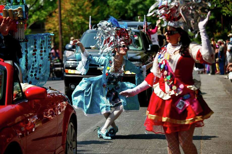 Marlina Meek, left, curtseys to the spectators while Terri Upton, right, waves during the King William Parade on Saturday, April 16, 2011. Meek and Upton are Consorts to The King, King Anchovy XLVI, the Ruler and Sovereign Head of Cornyation 2011. LISA KRANTZ/lkrantz@express-news.net / SAN ANTONIO EXPRESS-NEWS