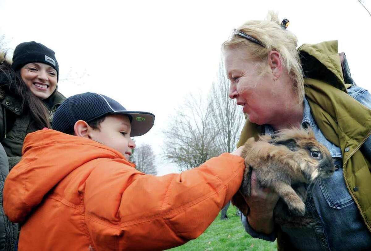 Julian Mendez, 6, of Norwalk, pets a Lionhead rabbitt held by Jane Reilly, president of the Greenwich Lions Club during the Greenwich Lions & ShopRite Annual Egg Hunt at Roger Sherman Baldwin Park, Greenwich, Saturday morning, April 16, 2011.