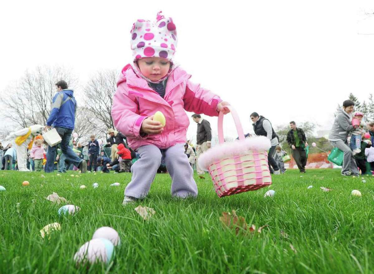 Hailey Woods, 1, of Stamford, grabs a plastic egg during the Greenwich Lions & ShopRite Annual Egg Hunt at Roger Sherman Baldwin Park, Greenwich, Saturday morning, April 16, 2011.