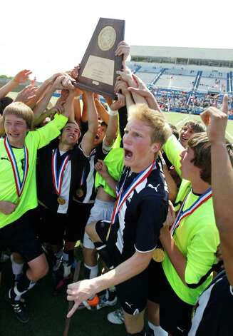 Boerne Champion's Bryce Barry (front) joins his teammates with the 4A state  championship trophy after defeating Kilgore 2-1 for the UIL Boys 4A  state soccer championship in Georgetown on Saturday April 16, 2011.  (Erich Schlegel/Special to the Express-News) / ©2011 Erich Schlegel