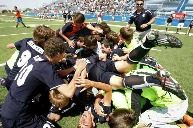 Boerne Champion celebrate into a pile after defeating Kilgore 2-1 for the UIL Boys 4A state soccer championship in Georgetown on Saturday April 16, 2011. (Erich Schlegel/Special to the Express-News) / ©2011 Erich Schlegel