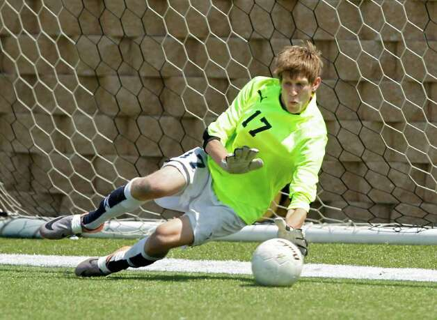 Boerne Champion goalkeeper Kyle Bullard (17) stops a penalty kick by Kilgore in the UIL Boys 4A state soccer championship in Georgetown on Saturday April 16, 2011. (Erich Schlegel/Special to the Express-News) / ©2011 Erich Schlegel